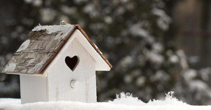 Cute birdhouse in the snow